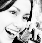 Girl Talking On The Telephone And Standing Outside
